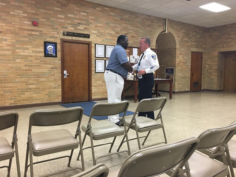 Police Commissioner Kevin Davis greets York Road Partnership resident.