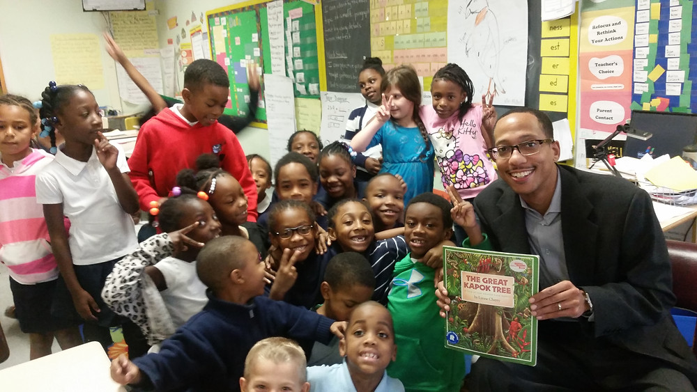 """""""John Bullock read to a third-grade class at Samuel F.B. Morris Elementary School on National Reading Day in March"""""""
