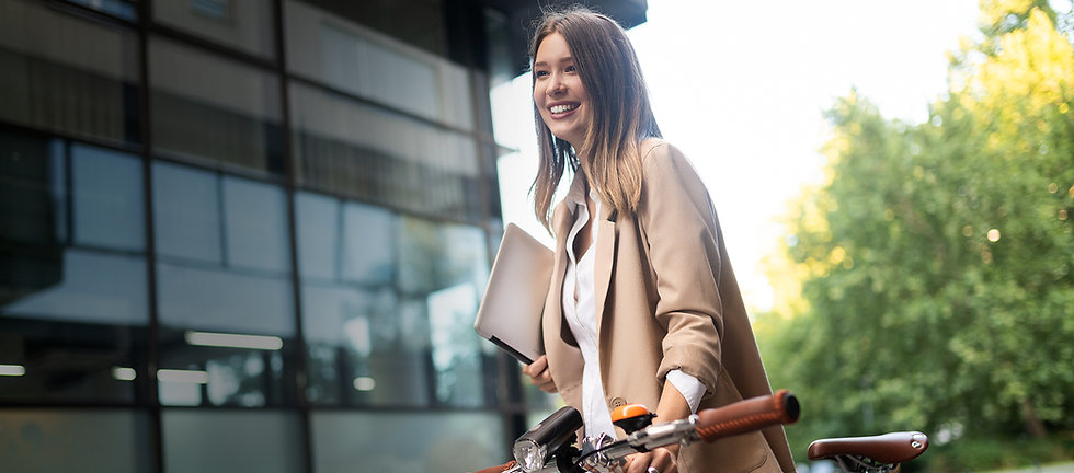business-woman-with-bicycle-to-work-on-u