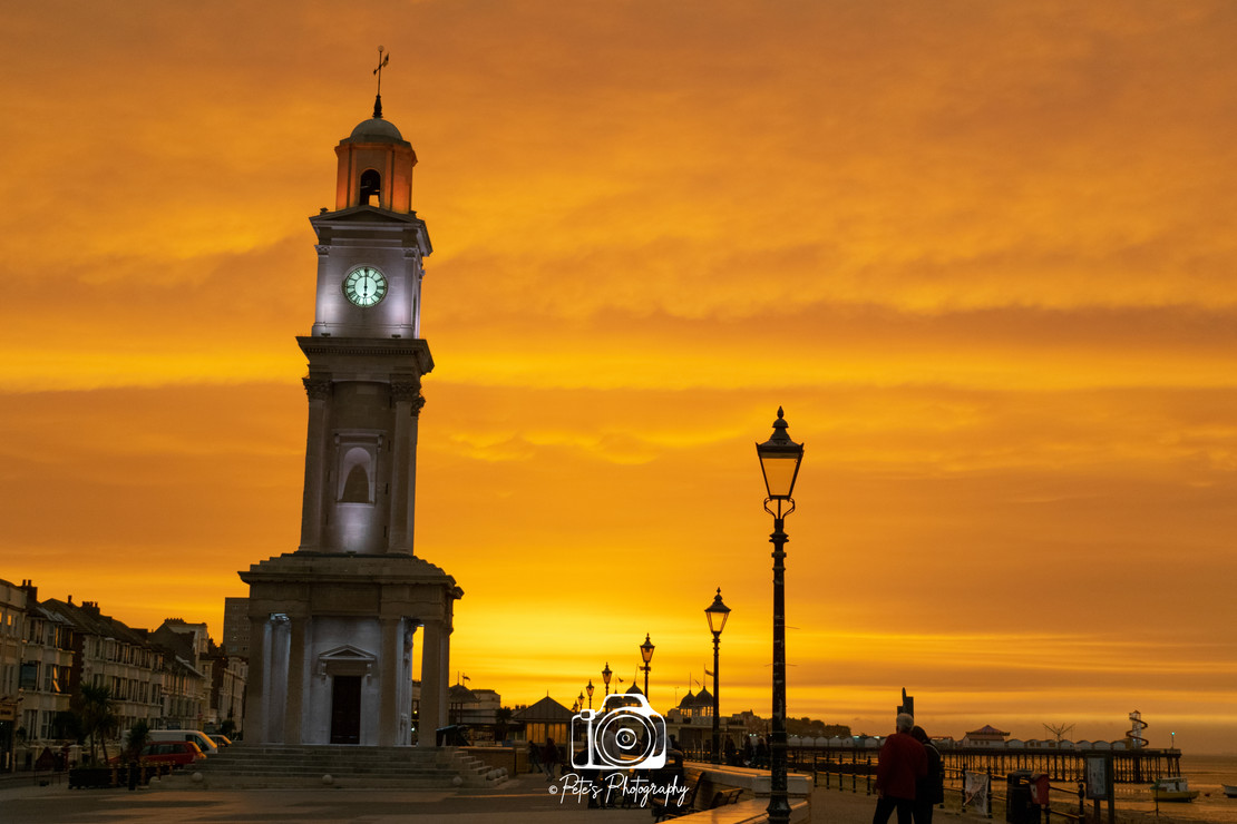 Orange Sky Over The Clock Tower