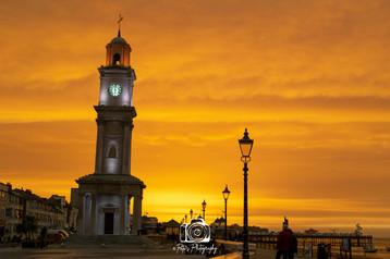 Orange Sky Over The Clock Tower