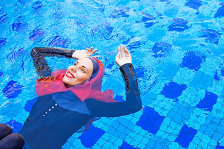 Canva - muslim caucasian woman swimming