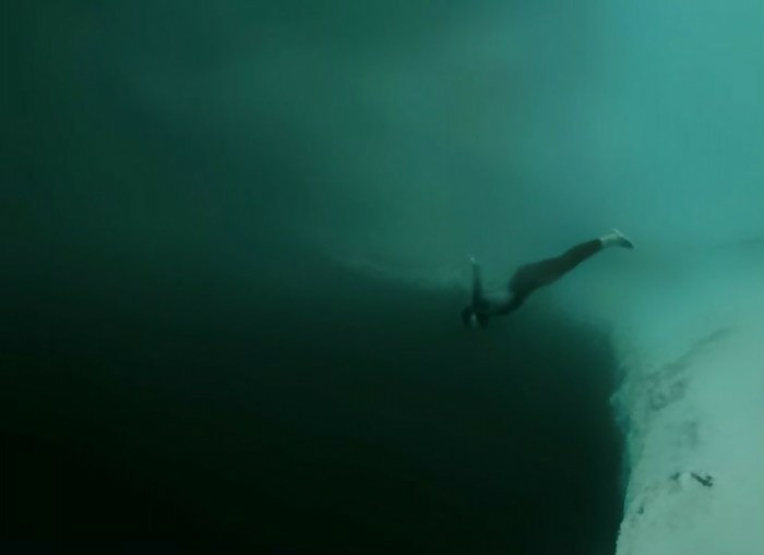 In this photo is a diver who is going down into the abyss. It is a scary scene, and this looks like a deep and endless hole in the ocean. It is now clear that swimming in the sea is not for everyone.