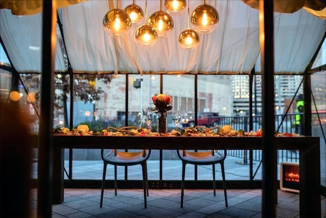 A table set for customers near a heated outdoor seating area at Lumen near beacon park in downtown Detroit.