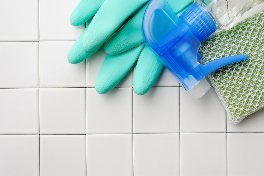household cleaning products against a tiled background