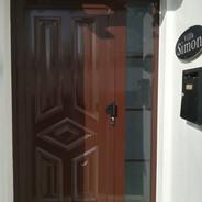 Paneled front door. Brown