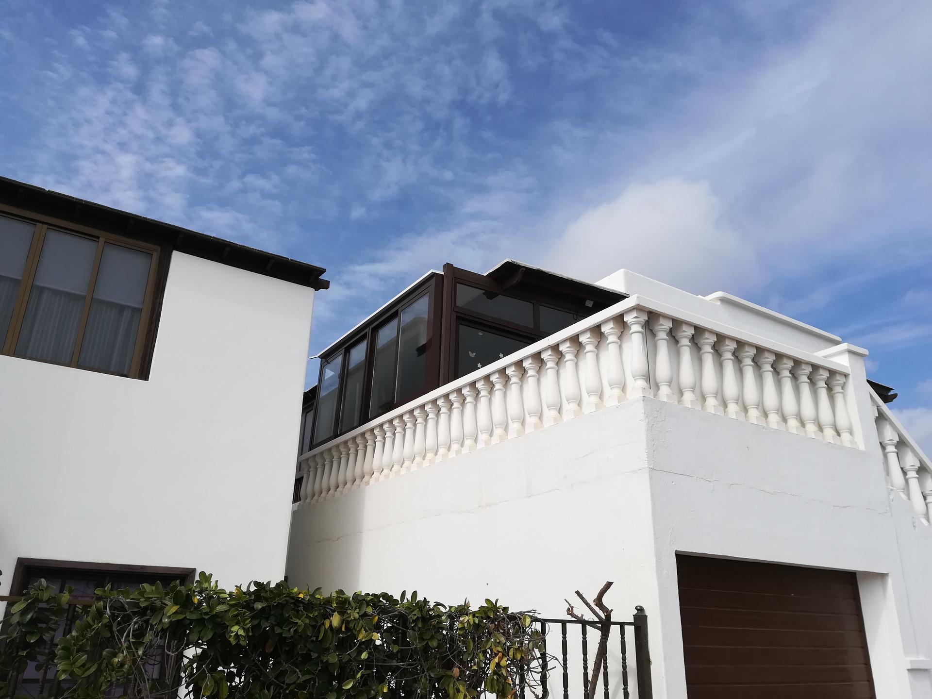 An enclosed balcony pergola