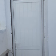 A white T&G style panneled door.
