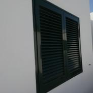 Dark green shutters