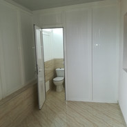 White paneled door and wall paneling