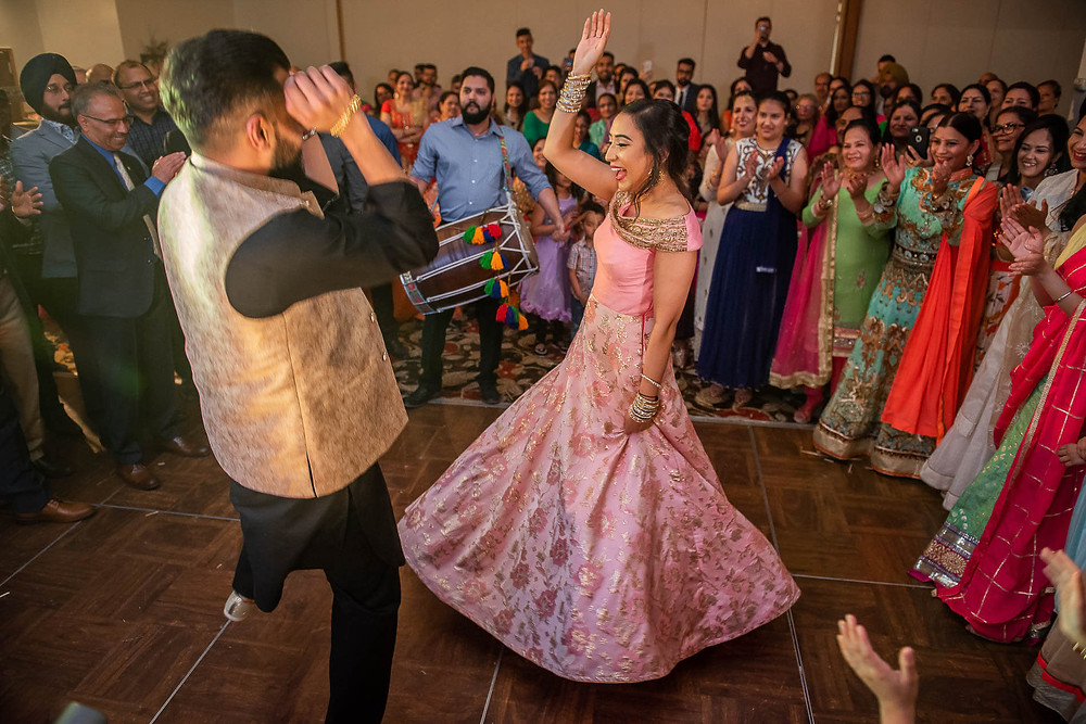 Bride and groom dancing together in a circle