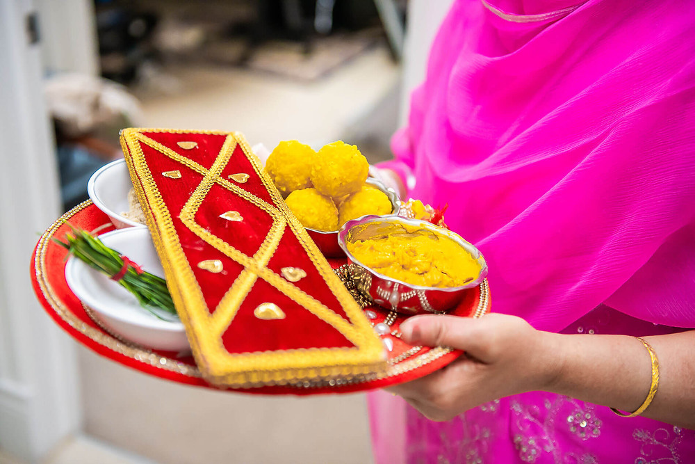 close up of the tray of punjabi traditional maiyan ceremony treats
