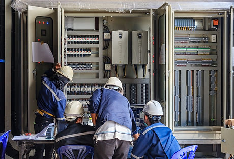 Engineer working on checking and maintenance equipment at wiring on PLC cabinet, Engineer checking s