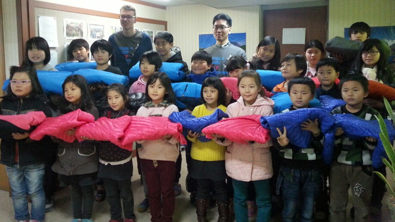 Keeping Kumkang School warm for the holidays - Arrival