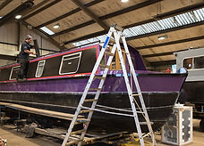 Boat being repaired in workshop