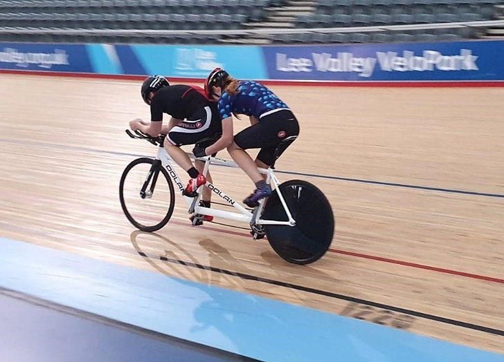 Tandem track cycling with pilot
