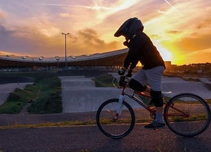 BMX cyclist on the track at sunset
