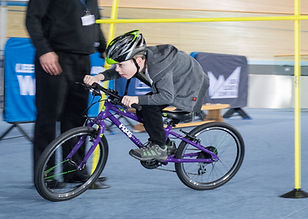 Child cycling on track centre