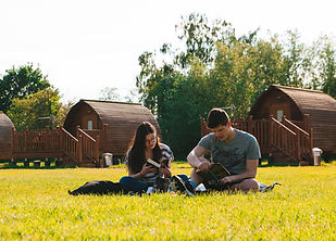 Couple reading in front of Wigwams