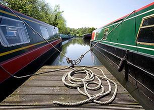 Narrowboats moored alongside a pontoon