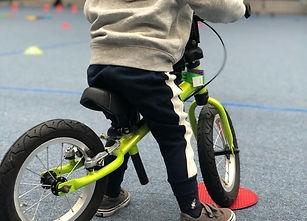 Child on balance bike for VeloBalance session