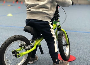 Close up of child on a bike