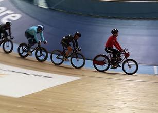Track cyclists following derny bike
