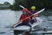 Two kids on a SUP board