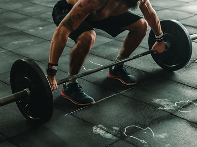 man-about-to-lift-barbell-2261477_edited