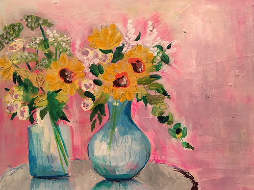 Yellow flowers in two blue vases