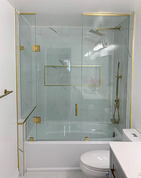 shower glass with gold hardware.jpg