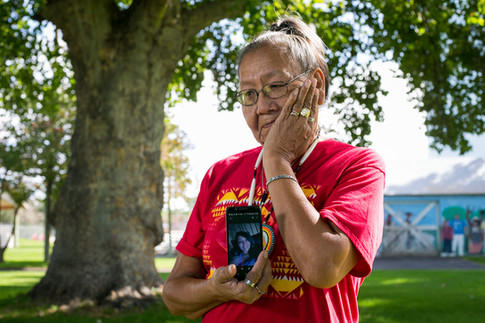 Verlynn Longee wipes away tears as she holds an image of her granddaughter, Rosalita Longee, on her cellphone Tuesday at Lions Park in Wapato. Rosalita, who would be 22 now, has been missing since June 30, 2015.