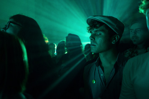 An spectator closes his eyes while to a performance by Valley Hush Saturday, Sept. 26, 2015, during Hell's Half Mile Film and Music Festival at Old City Hall in downtown Bay City, Mich.