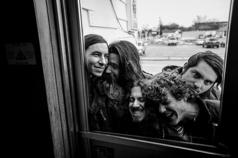 Nick Chevillet, left, Andrew Pawelski, Jesse Shepherd-Bates, Joel Sanders, and Joby Kaslowski of the band The Handgrenades pile on top of each other for a portrait Monday, July 14, 2014, at Bell Bar in Bay City, Mich.