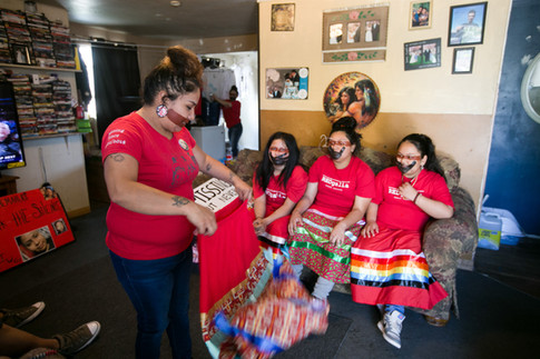 From left: Cissy Strong Reyes unfolds her ribbon skirt Sunday, May 5, 2019, as she prepares for the national Missing and Murdered Indigenous Women march with Vanna James, Zamora Strong and Irenne Lawrence in Toppenish, Wash.