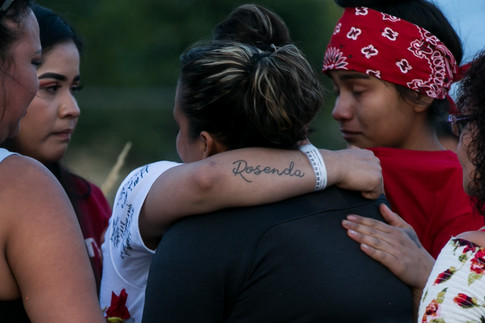 """A tattoo on Karman Strong's forearm reads """"Rosenda"""" in memory of her mother who went missing in 2018."""