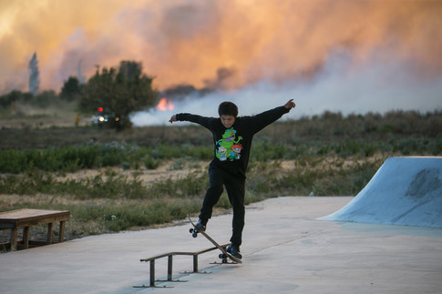 Davis Eneas, 15, skateboards as a large brush fire burns near White Swan, Wash. on Friday, August 10, 2018. The fire was reported around 3:30pm on Hawk Road, about halfway between White Swan and Fort Simcoe State Park. So far it has burned an estimated 80-130 acres and is threatening structures said Horace Ward, senior emergency planner with the Yakima County Office of Emergency Management.