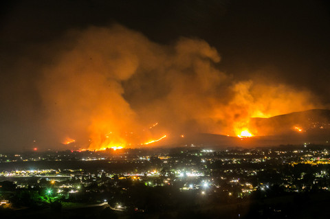 Ahtanum Ridge is seen ablaze looking south from the Uplands Trail of Cowiche Canyon in Yakima, Wash., on Sunday, Aug. 16, 2020.