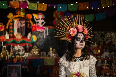 Esmerelda Manjarrez, the new La Catrina for the annual Día de los Muertos Community Celebration, poses in front of an ofrenda Sunday, Oct. 18, 2020, at the Mighty Tieton Warehouse in Tieton, Wash.