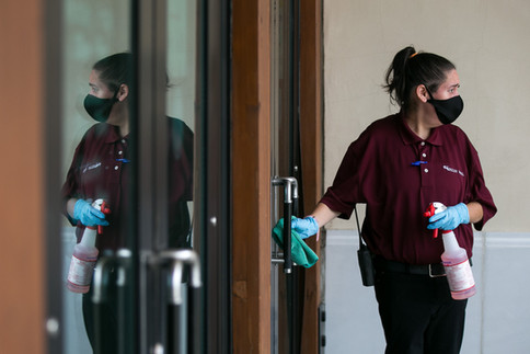 Jessica Holbrook, 33, a contracted janitor with Valley Mall, disinfects a doorway Friday, July 24, 2020, at Valley Mall, 2529 Main St. in Union Gap, Wash. Holbrook, who shared that she has a learning disability, has been working at the mall since October of last year. The Americans with Disabilities Act will be celebrating its 30th anniversary on Sunday.