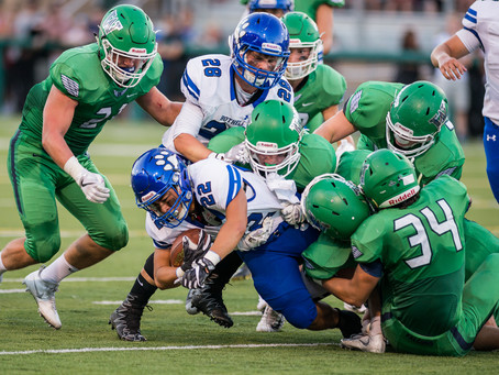Woodinville chews up rival Bothell in season opener