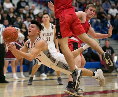 Toppenish's Manuel Felan, left, dives against Clarkston in a Class 2A regional tournament Saturday, Feb. 29, 2020, at Eisenhower High School in Yakima, Wash. Clarkston defeated Toppenish 53-49.