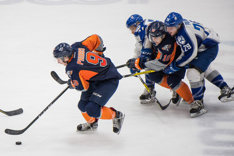 Flint Firebirds' Jack Phibbs (9) drives toward the net as C.J. Clark defends against the Sudbury Wolves Friday, March 3, 2017, at the Dort Federal Credit Union Event Center in Flint, Mich.