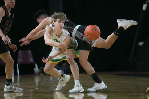 Toppenish's Matthew Ramirez, right, soars over Lynden's Jordan Medcalf in the quarterfinals of a Class 2A state tournament Thursday, March 5, 2020, at the SunDome in Yakima, Wash. Lynden defeated Toppenish, 73-55.