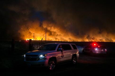 Fire crews battle a large brush fire onAhtanum Ridge in Yakima, Wash. on Sunday, Aug. 16, 2020.