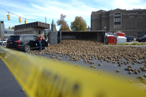 A Sugar beet truck carrying beets tipped over at the intersection of North Madison and Center avenues in downtown Bay City, Mich., dumping part of its load onto a vehicle in the Alice & Jack Wirt Public Library lot. The incident occurred after 1 p.m.