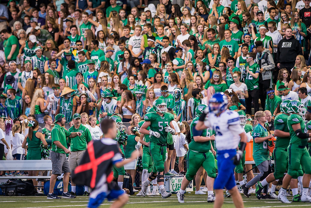 Woodinville High School fans watch in the stands during the Bothell vs. Woodinville Kingco 4A football game Friday.