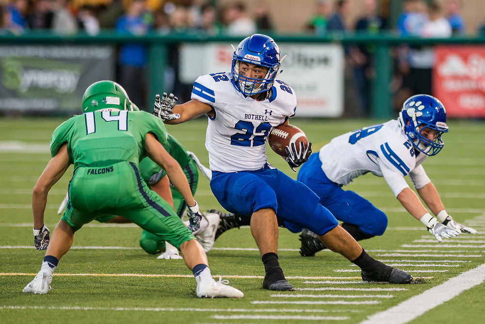 Bothell running back Christian Lee Galvan attempts to run the ball against Woodinville during the Bothell vs. Woodinville KingCo 4A football game Friday.