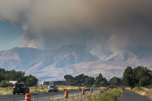 Haze and smoke blankets the sky over Naches as the Evans Canyon Fire continues to burn, seen from U.S. Highway 12 in Naches, Wash., Thursday, Sept. 3, 2020.
