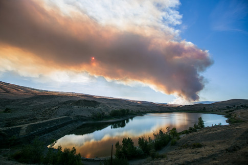 A wildfire in the Evans Canyon area is seen here looking north of Wenas Lake Monday, Aug. 31, 2020, on North Wenas Road in Wenas, Wash.